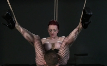 Redhead with tied up big tits