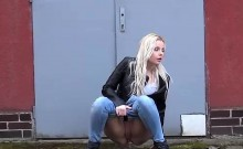 Amateur babe using the side walk as her toilet