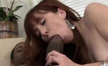 Sexy redhead swallows black dick