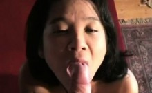 Exposed Asian Mature Hooker swallows