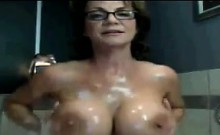 Busty Mature Woman In The Bath Tub