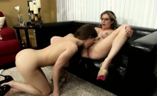 Blonde and brunette beauties set up a lesbian encounter on the couch