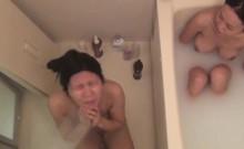 Bathing asian masturbates