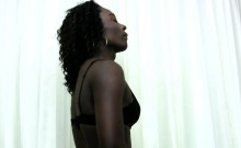 Curly Black Tranny Strips Down And Deepthroats White Shaft