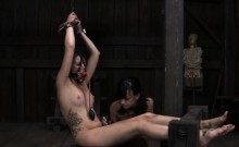 Restrained gal is hoisted up for her sexy torment