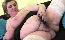 Huge titted granny playing with her boobs and toying
