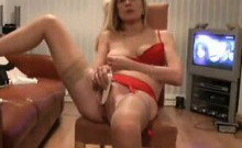 Cock-hungry mature blonde moans while playing with her favo