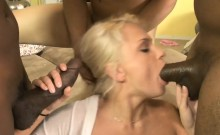 Naughty blonde slut double fucked by big black shafts