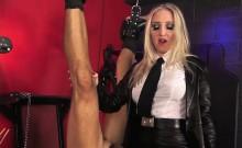 Mistress dominates suspended sub with dildo