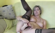 Cute mature CD in stockings toying