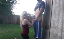 Outdoor blowjob from a blonde slut in public