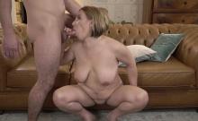 Busty granny sucking cock