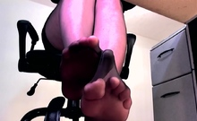 Sexy pantyhose legs and high heel dangle